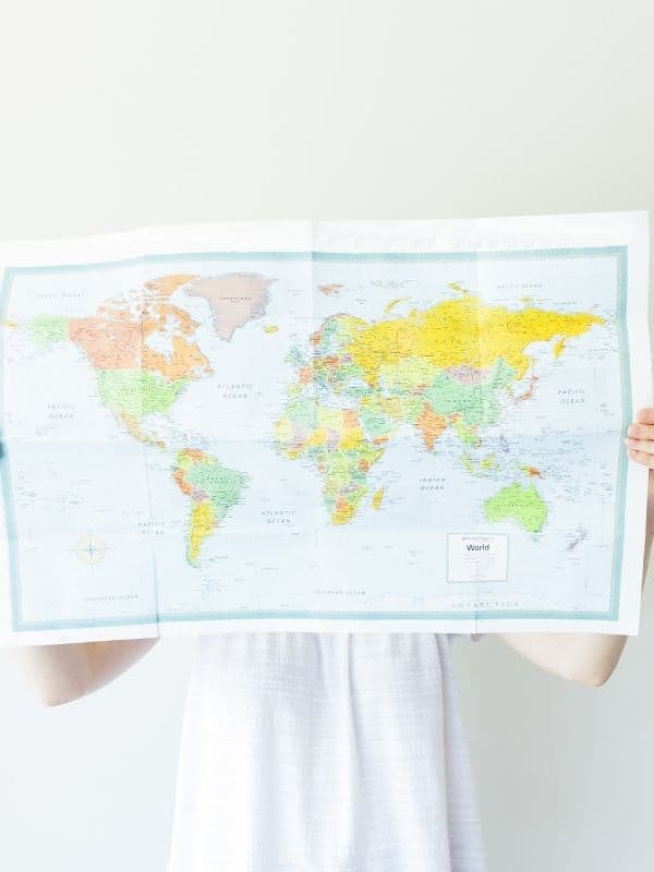 Picture of a woman holding a world map.