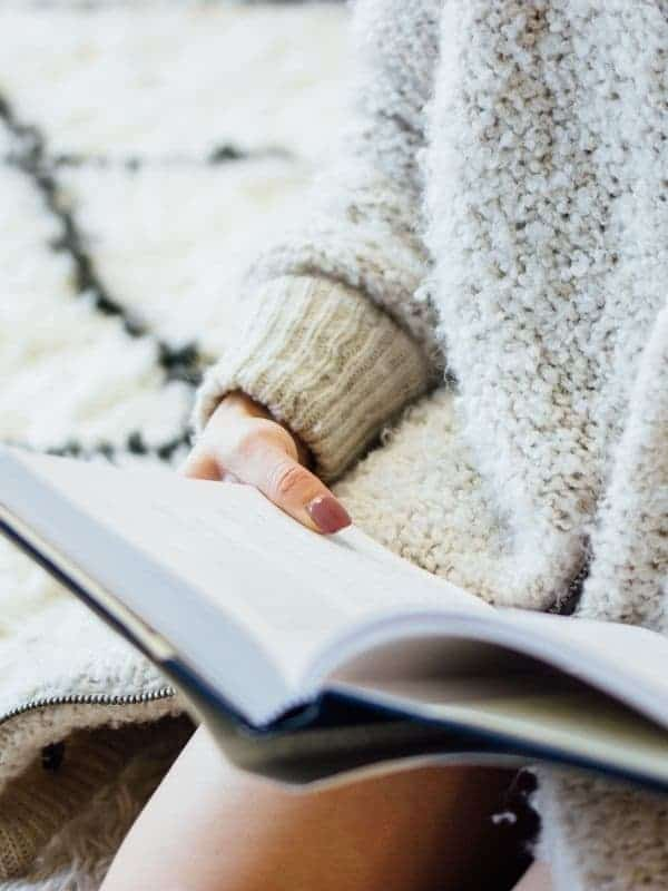 Photo of a woman reading.